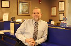 David Bridgeman, CEO of Pinnacle Bank in Orange City, Fla., says his bank's examination by the FDIC and state included 21 examiners for his 28-employee bank and took twice as long as usual.