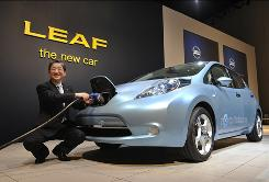 Toshiyuki Shiga, of Japan's Nissan Motor, demonstrates charging the Nissan Leaf electric vehicle.