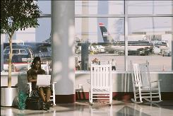 "A traveler rocks at Charlotte Douglas International Airport. The chairs ""humanize the travel experience,"" says traveler Don Shapiro."