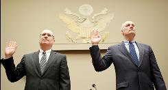 Former Executive Vice President and Chief Business Officer of Fannie Mae Robert Levin (L) and former President and Chief Executive Officer of Fannie Mae Daniel Mudd (R) are sworn in during a hearing before the Financial Crisis Inquiry Commission April 9, 2010 on Capitol Hill in Washington, D.C.