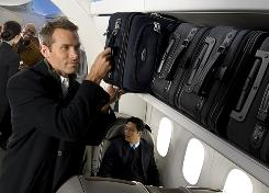 "Plans to start charging for putting bags in overhead compartments have some federal officials talking about taking action on unfair ""hidden"" feees."