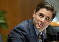 FCC Chairman Julius Genachowski faces a tough decision over high-speed Internet access in the USA.