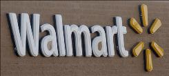 A redesigned Wal-Mart sign with a more subtle color scheme hangs on store #1 on Wednesday, Oct. 29, 2008, in Rogers, Ark.