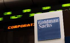 Stock prices whiz by on a ticker near the Goldman Sachs booth on the floor of the New York Stock Exchange.