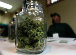 A jar of marijuana is seen on a vendor table at the Cannabis Crown 2010 expo April 18 in Aspen, Colo.