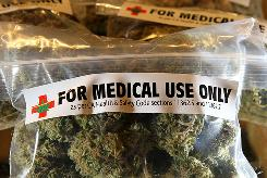 One-ounce bags of medicinal marijuana are displayed at the Berkeley Patients Group in Berkeley, Calif.