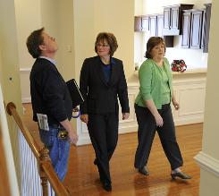 Realtor Lacy Williams, center, attends a walk-through of a house she sold with Jeff Scott of StyleCraft Homes and Carolyn Mustian. Mustian's son is buying the Richmond, Va., house.