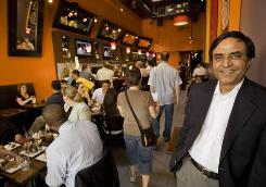 Ashwani Dhawan recently opened the Slider Bar Cafe, his second restaurant in Palo Alto, Calif. Business at his first eatery is up, a reflection of rising optimism in Silicon Valley.