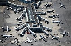 Planes jockey for position on the tarmac around a terminal building at LaGuardia airport in New York.