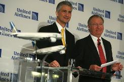 Continental CEO Jeff Smisek, left, and United CEO Glenn Tilton announced a merger agreement that will create the world's biggest airline.