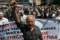 Greek pensioners march in the center of Athens on Tuesday to protest against austerity measures.
