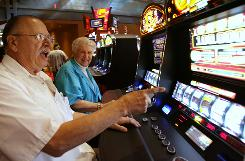 Vito Valentinetti reacts with his wife, Mary Ann, after a win in May 2009 while playing a slot machine at the Sands Casino Resort Bethlehem in Bethlehem, Pa.