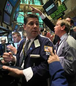 Traders work the floor of the New York Stock Exchange May 7, 2010. Stocks were volatile again Friday.