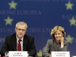 European Commissioner for Economic Affairs Olli Rehn, left, and Spanish Finance Minister Elena Salgado participate in a media conference at the emergency meeting of EU finance ministers in Brussels.