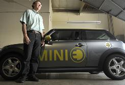 AC Propulsion CEO Tom Gage, at a garage at the company's offices in San Dimas, Calif., shows a Mini Cooper his company has converted to run on electricity.