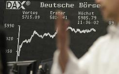 A trader sits in front of a board displaying the DAX index of leading shares on Monday in Frankfurt. The index gained more than 5%.