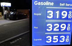 A motorist fuels up at a gas station in San Jose, Calif., Tuesday, May 11, 2010. Experts now say prices have probably peaked for the summer.