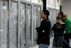 Job seekers look at job listings posted on bulletin boards at the Career Link Center One Stop job center in San Francisco.