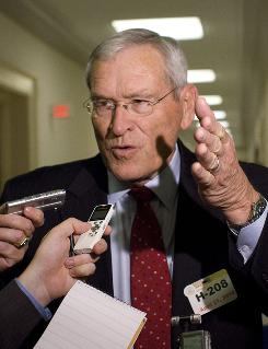 General Motors CEO Ed Whitacre talks with reporters following a meeting with the Michigan Congressional delegation in the Rayburn House Office Building on Capitol Hill in Washington, in this file photo.