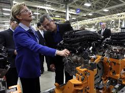 Michigan Gov. Jennifer Granholm, left, and plant manager Donald DeKeyser tour an auto factory inTrenton, Mich.