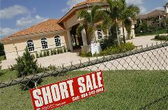 A brand-new $1.1 million, 5,200 square foot home in Davie, Fla. is offered for short sale. A short sale is when banks agree to let borrowers sell their homes for a reduced price if they owe more than it's worth.