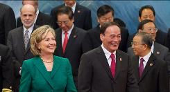 Secretary of State Hillary Clinton stands with Chinese Vice Premier Wang Qishan. Nearly 200 Americans are in China to discuss economic policy.