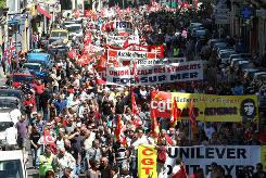 Workers march during a protest in Marseille, southern France, on Thursday over plans to raise the retirement age past 60. Strikes delayed flights, closed schools and frustrated commuters.