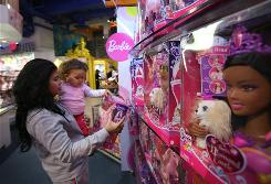 A mother and daughter shop for a Barbie at a New York Toys R Us in 2008.
