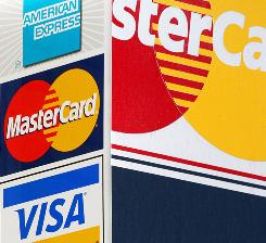 Credit card signs are posted outside a New York parking garage.