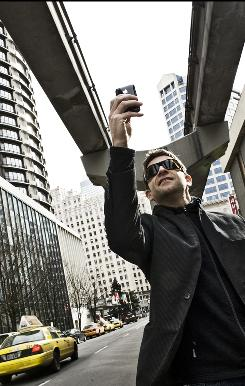 Seattle photographer Chase Jarvis shoots an image using the camera on his Apple iPhone.