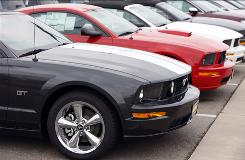 Mustangs sit at a dealership in this 2009 photo. Many automakers saw sales increase from last May.