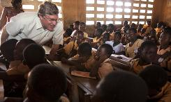 Gates Foundation CEO Jeff Raikes visits a school in Ghana to observe a nutrition program the foundation supports.