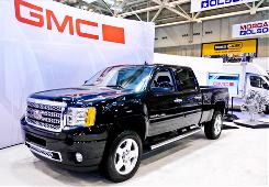 General Motors sales were spurred by a big government fleet contract.