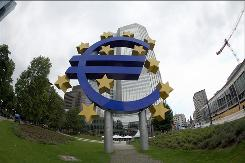 A giant symbol of the European Union's currency, the euro, stands outside the headquarters of the European Central Bank in Frankfurt.