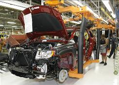 A Chrysler employee works on the assembly line making the new Jeep Grand Cherokee on May 21 at the Chrysler Jefferson Avenue Plant in Detroit.