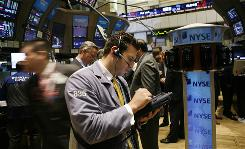 Traders and specialists work the trading floor of the New York Stock Exchange Friday.