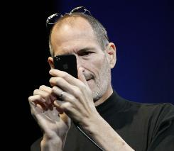 Apple CEO Steve Jobs uses the iPhone 4 Monday at the 2010 Apple Worldwide Developers Conference in San Francisco. It goes on sale June24.