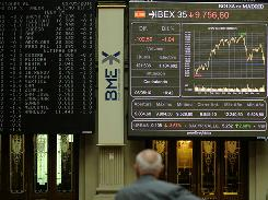 A man looks at the stock index curve at Madrid's stock exchange.