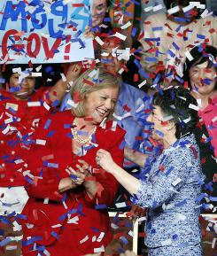 In California, confetti rains down as Meg Whitman, left, winner of the Republican nomination for governor, and Carly Fiorina, the GOP nominee for the U.S. Senate, celebrate after Tuesday's election.