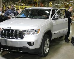 Chrysler Group CEO Sergio Marchionne gets out of a new 2011 Chrysler Jeep Grand Cherokee during a celebration of its production launch at the Jefferson North Assembly Plant in Detroit.