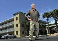 Baker Clark owns a Best Western hotel in Navarre, Fla. and his business has plummeted since the Gulf oil spill. Clark's business interruption insurance doesn't cover environmental disasters, he says. 