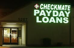 Neon signs illuminate a payday loan business in Phoenix, one of 650 operating in the state with some open 24-hours a day.