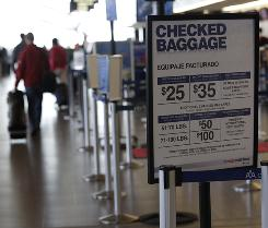 In addition to checked baggage fees, American Airlines is looking at new fees for boarding early and switching flights.