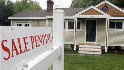 A sign announces a residential home sale is pending in the Boston suburb of Framingham, Mass. A rush of consumers aiming to meet a deadline to qualify for a federal tax credit pushed the number of buyers signing contracts to purchase homes higher.