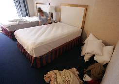 Hotels are looking to save money and are asking guests if they will forgo a daily changing of sheets and towels.