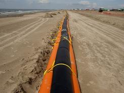 A tiger dam boom is laid out the full length of the Grand Isle  Beach, La., on Thursday to try to stop oil from the spill.