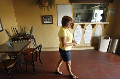 Vicki Guillot walks through her restaurant, Debbie's Cafe, which she had to close this week in Gheens, La., because the oil spill has created a shortage of shrimp and customers.