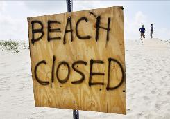 he beach at Grand Isle, La., is closed as workers continue to clean up from the oil spill.