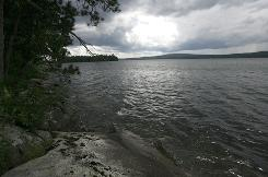 Lake Memphremagog, part of a parcel of land left to the U.S. government, is seen from the shore of Eagle Point in Derby, Vt., Tuesday, June 29, 2010.