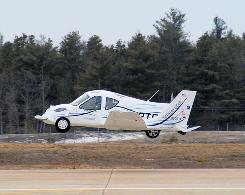Terrafugia says its car-plane, the Transition, will cost about $194,000. Here it is seen shortly after a takeoff.
